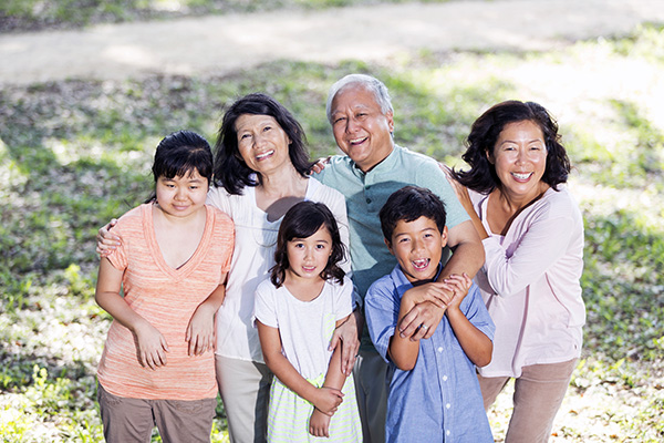 Multi-generation Japanese family with autistic adult daughter (20s), on left.